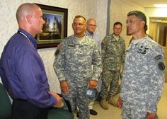MCDONALD ARMY HEALTH CENTER, FORT EUSTIS, VA – As Medical Director of the Integrated Disability Examination System (IDES), Dr. Paul Duch (left), oversees the benefits processing for wounded, ill and injured service members. He recently met with Brig. Gen. Joseph Caravalho, Jr., commanding general, Northern Regional Medical Command, Fort Belvoir, Va., and explained how Soldiers are benefited from using IDES.  (Photo by Marlon J. Martin, Public Affairs Officer, MCAHC