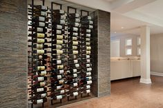 Lateral wine racks, with LEDs to illuminate the labels without adding heat, show off those collectible labels.