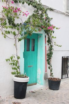 Turqoise door in Old Town Ibiza, Spain.