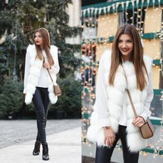 Wearing a fluffy white fur vest in the festive lighted city today on my blog: http://themysteriousgirl.ro/2015/12/snowflake-vest/