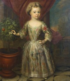 English School, early 18th century PORTRAIT OF A GIRL, A DAUGHTER OF HENRY, DUKE OF KENT, STANDING FULL-LENGTH, WEARING AN EMBROIDERED DRESS, PLUCKING SOME ORANGE BLOSSOM.