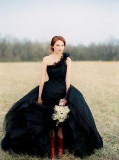 Black wedding dress and cowboy boots!THIS IS DEF ME!:)