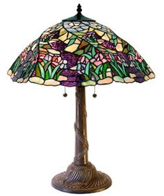 Illuminate your home with the colorful stained glass of this artistic Tiffany-style reproduction table lamp.