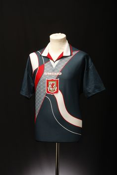 This football shirt is from Umbro's archive. We've been slowly trying to collect and catalogue all our old kits (see our blog post for more details). If you know anything more about this shirt (such as what season it's from), please help us out by adding comments and tags.