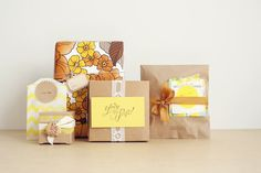 - Cute paper bags  - Stacked paper  - Typed on cool-shaped stickers  - Vintage wallpaper re-usage.