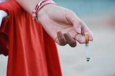 Woman Holding Burning Cigarette in Hand by Mark de Scande on 500px