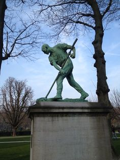 Statue of a harvest man in Parc du Cinquantenaire, Brussels Belgium, by Belgian sculptor & painter Constantin Meunier, whose important contribution to modern art is the introduction of the image of the industrial worker, docker and miner, as an icon of modernity. His work is a reflection of the industrial, social and political developments of his day and represents a compassionate and committed view of man and the world.