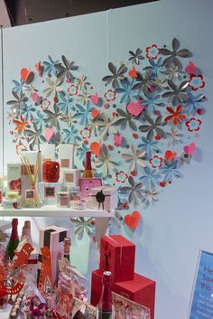 John Lewis 2013 Valentine.. wont you be mine with...160 chickens fret cut from light weight metal spray finished in 2 colours. Flowers cut from metal with creased and hand bent petals so each looked different!! Hearts.. Fret cut from paper with a crease to make 3d in all 1071 metal flowers, 3 sizes, 4 colours 624 paper hearts 1120 vinyl dots.