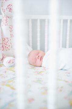 Love this simple newborn photo of baby sleeping in the crib