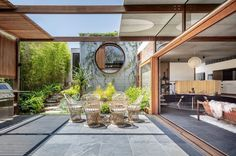 """Bell Landscapes on Instagram: """"This courtyard space from our Russel lee project is a stunning area for entertaining at any time of the year. The flow of the flooring…"""" Indoor Outdoor Living, Outdoor Spaces, Outdoor Decor, Outdoor Dining, Studios Architecture, Architecture Details, Architect House, Home Additions, Prefab Homes"""