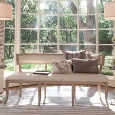 This lovely bench features a natural wood frame and a beige leather seat and back. Would work great in any room that needs a little extra seating. The bench measures 73