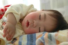 There are lots of photo ops when your baby is awake, but don't forget to snap some photos when they're dozing, too.