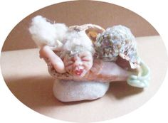 Mermaid stuck in broken shell by regiooaksartist on Etsy, $30.00