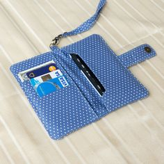 IPHONE WALLET Blue Polka Dot,sewn by blue polka dot fabric. It's cute and beautiful, looks good with cheap price.