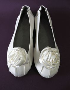 Beautiful, white bridal flats are the perfect accessory for any bride. If you already tower over your man in heels, then you may want to pick wedding shoes that aren't too high. Bridal ballet flats also give your feet a rest at the reception, so you can wear your gorgeous heels down the aisle and