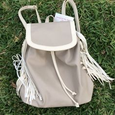 NWT Big Buddha Nude & Ivory Fringe Backpack Gorgeous with gold metal accents, adjustable straps, spacious, functional, trendy fringes on both sides, magnetic snap closure. Brand new with tags MSRP $95 plus tax Big Buddha Bags Backpacks