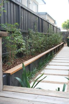stepping stones,bamboo and a retaining wall that doubles as a seat.Garden design by RPGD. www.rpgardendesing.com.au