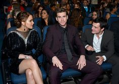 Jennifer Lawrence, Liam Hemsworth, and Josh Hutcherson sitting together at the 2013 People's Choice Awards held at Nokia Theatre L.A. Live on 01/09/12. Liam looks like the third wheel as usual haha