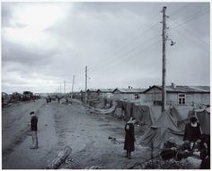 Huts along the street through the Bergen-Belsen concentration camp, 28 April 1945. Photo by Sgt. Curtis, U.S. Army Signal Corps. NARA, Washington DC.