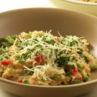 Mock Risotto....Risotto is hardly effortless fare, what with all that stirring over a hot stove. But instant brown rice and creamy Neufchatel cheese can make a nutty, rich, stand-in version that's sure to be a family favorite.