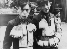 Warsaw, Poland, Children selling armbands and Jewish badges, 1939.
