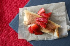 Fried cheesecake burritos topped with strawberries
