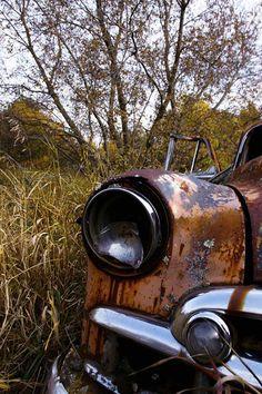 Missing headlight  rusty abandoned car