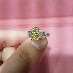 Fancy yellow diamond three Stone ring in platinum & 18kt yellow gold. Get in touch with us today by visiting www.delicategem.com #diamond #diamonds #diamondring #ring #rings #jewelry #diamondjewelry #engagementring #engagement #engagementrings #weddingrin