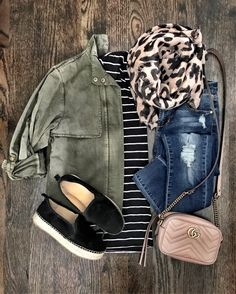 Military green jacket, black striped top, skinny jeans, black tennies, leopard scarf, camel crossbody bag
