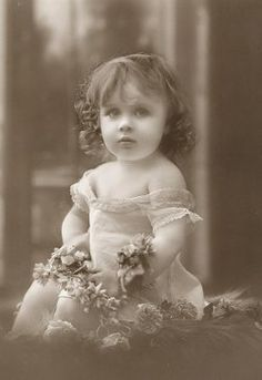 Sweet antique baby girl photo.