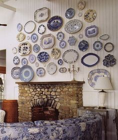 PLATES - such a great collection of blue and white wall hanging plates