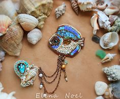 Embroidered brooch with turquoise pearls and amber. от ElenNoel, $129.00
