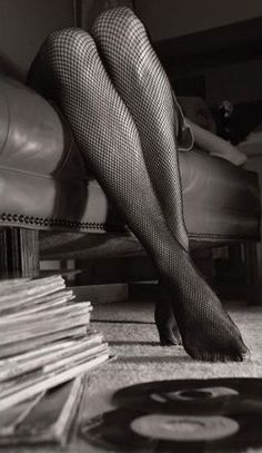 Fishnets and vinyl~~~~AND I WORE THE FISHNETS AND I HAD THE VINYLS...STILL DO~~