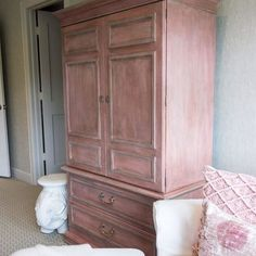 A revamped armoire makes a stylish focal point in a living room and adds much needed storage space, too. We're crushing on this piece painted by Portilla Design with Chalk Paint® in Scandinavian Pink and French Linen and then finished with Clear and Dark Chalk Paint® Wax.