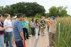 Biology students getting a tour from a volunteer docent at Volo Bog.
