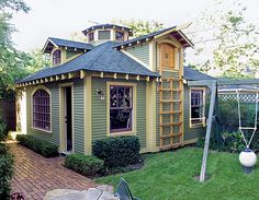 SHEDS WITH STYLE  --  Playhouse and storage in an old garage.