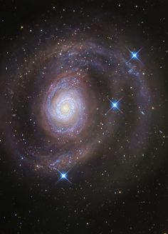 M94 lies 15 million light-years distant in the northern  constellation Canes Venatici. The brighter inner part of the face-on spiral galaxy is about 30,000 light-years across. A new multi-wavelength investigation has revealed previously undetected spiral arms sweeping across the outskirts of the galaxy's disk. Credit: R Jay Gabany.