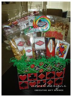 so you dont have to have a Vegas theme but abasket made up with snacks and games for the bride and groom would be perfect!!