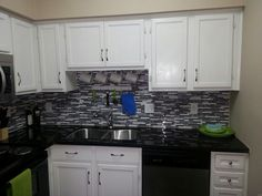 Updated kitchen (updates in 2014)! Granite counter with glass/stone backsplash, under mount stainless sink, and new faucet.  #forsale #condo #houstoncondos #houstonrealestate #realestate #kitchen