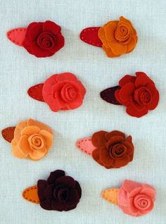 With Valentine's Day coming up I designed these little girl's barrettes in celebration of the rose. I liked the idea that they could add a little Valentine's spirit to any outfit, and also to be used long after the big day. --Molly