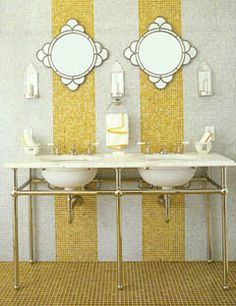 Loving the yellow tile stripes and mirrors.