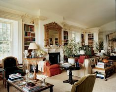 """Architect Ernesto Buch worked with de la Renta to create a magnificent room that functions as a living space, library, and bedroom. The mantel is the model for one installed at Houghton, and the William Kent table to its left was found in London. The Louis Seize chairs in the foreground and the Kentian banquette were in Annette de la Renta's former country house.   """"A house in the country is the work of a lifetime"""" says Oscar de la Renta. """"You see the evolution of your own life in a way"""""""