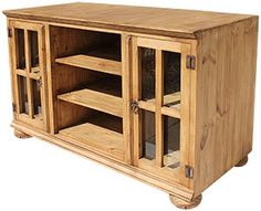 The Andrea TV Stand w/Bunn Feet features extra-tall glass door cabinets with interior shelves, perfect for keeping all of your movies or CDs on display and dust free. The middle cubby holes are ideal for your cable box, DVD player, and other electronic equipment. Iron hardware and solid-wood construction complete this rustic piece.