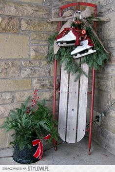 Sled and ice skates with pine and plaid ribbon