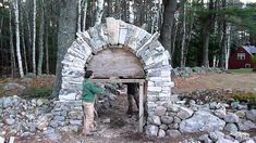 This arch was built with no mortar and no heavy equipment. All the stone was found on site, roughly 12 tons of granite. Construction began four feet below ground, with a compacted base of rip rap and crushed stone. This clip captures the moment the form is knocked out and the structure stands on its own.