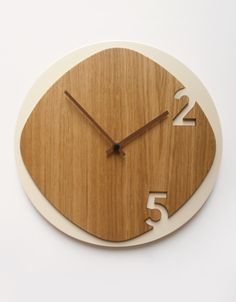 The clock is really an important part for a home. Not only to show the time, but a clock also is a home decoration. That's why we should not put it easy when we choose what clock for our wall… Continue Reading → Wall Clock Oak, Wall Clock Design, Diy Clock, Wood Clocks, Clock Decor, Cnc, Unusual Clocks, Modern Clock, Easy Diy Projects