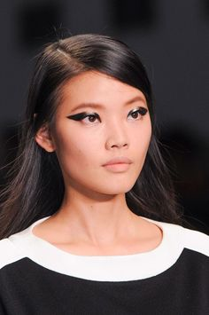 Is she a 60s beauty or a biker rock chick? We LOVE this liner hybrid which came courtesy of the MAC Pro Black Crème Liner. That's how to wing it next season. The hair featured an of-the-moment low side parting. This trend is all about strong lines.   -Cosmopolitan.co.uk