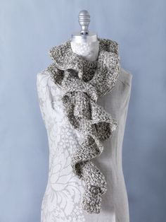 ruffle scarf - free crochet pattern.  Kelsey.....this is the pattern.  It calls for double thread....I just used one to make it lighter and softer.  Holly, Sarah wanted a copy of this.