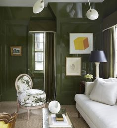 Room of the Day - has the Veere Grenney vibe going with green walls, green and white floral print, white sofa and yellow accents 5.6.2017