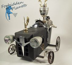 The King Of The Road. He is a full bodied robot sitting in an open wheeled race car.